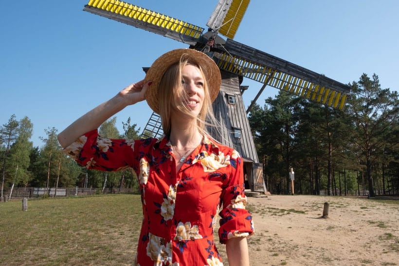 things to do on your gdansk trip, posing in front of the windmill at the Wdzydze Ethnographic Museum