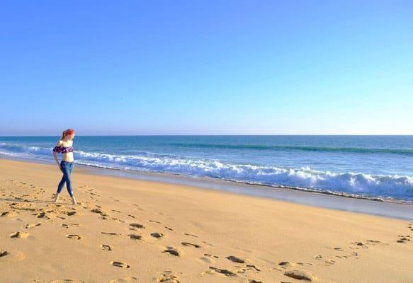 winter in the algarve, walking along the sandy beach
