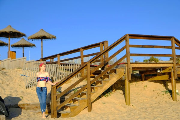 where to get winter sun in algarve, posing at the pier on quinta do lago beach
