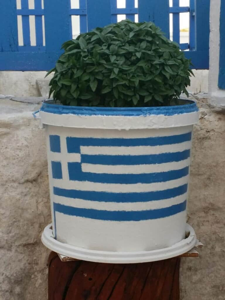 what to do in paros greece, flower pot painted with greek flag