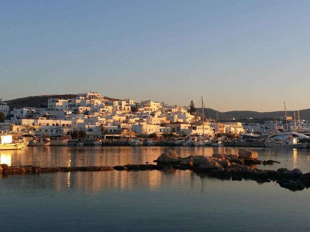 activities in paros island, sunset over the seaside town of Naoussa