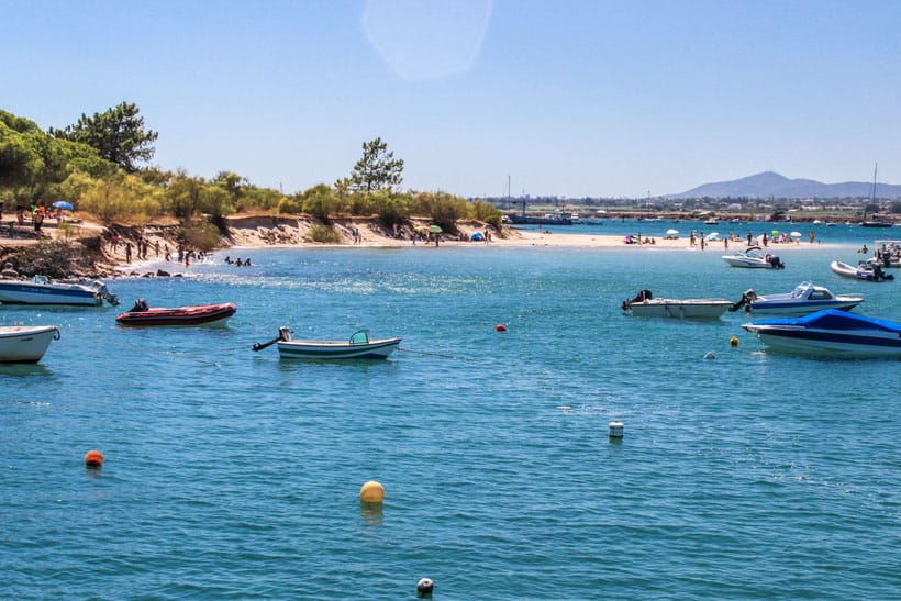 tourist attractions in algarve, boats surrounding tavira island