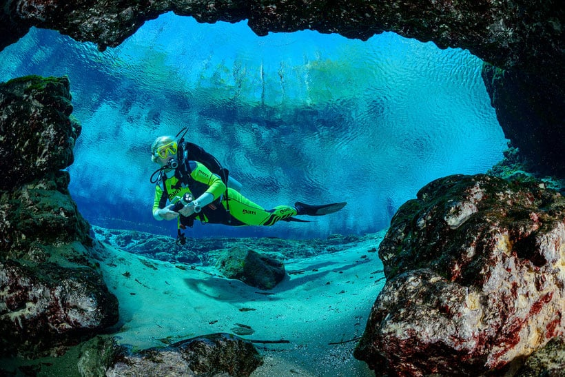Best Things to do in Apostle Islands underwater, A man scuba diving in the island