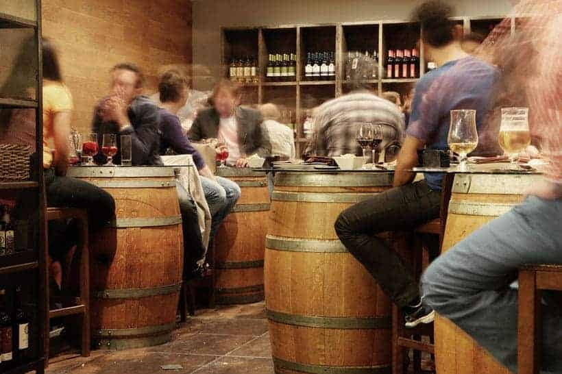 places to eat in marbella, people drinking at tables made of wine vats