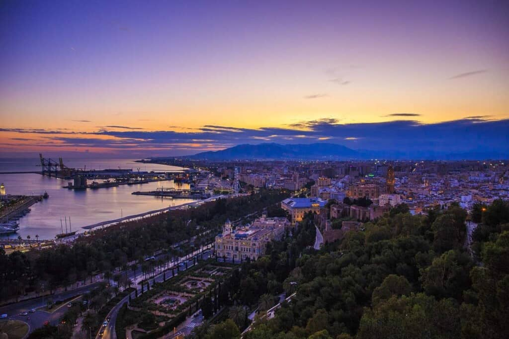 best places to visit near marbella spain, aerial view of malaga at night