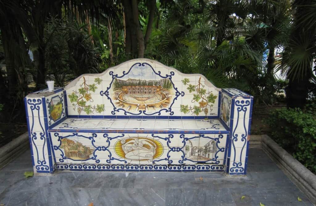 things to see in marbella, intricate park bench in marbella made of ceramics