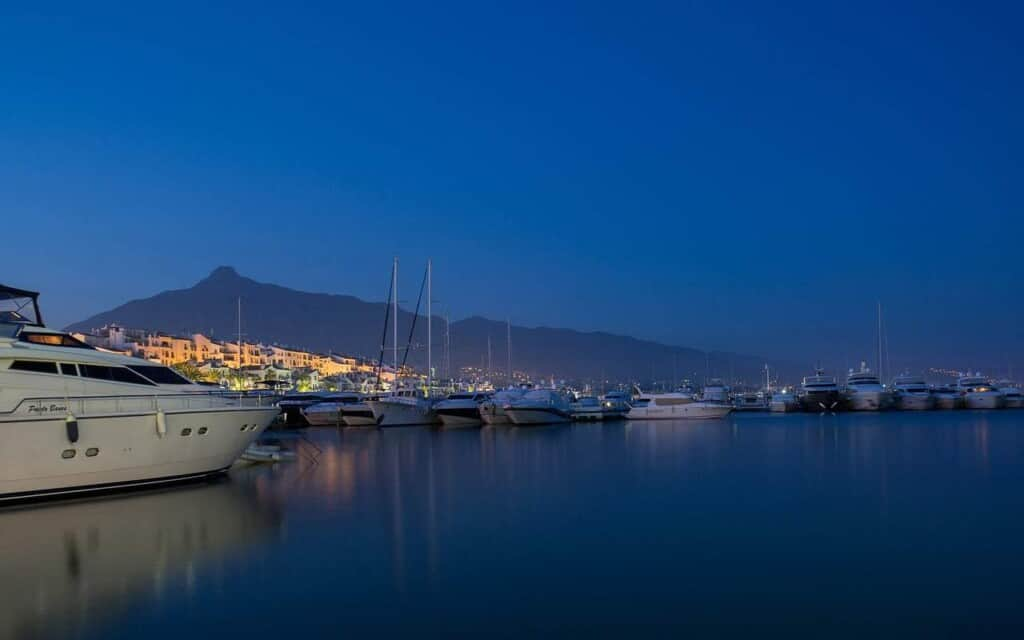 best places in marbella, nighttime view of boats on the waterfront