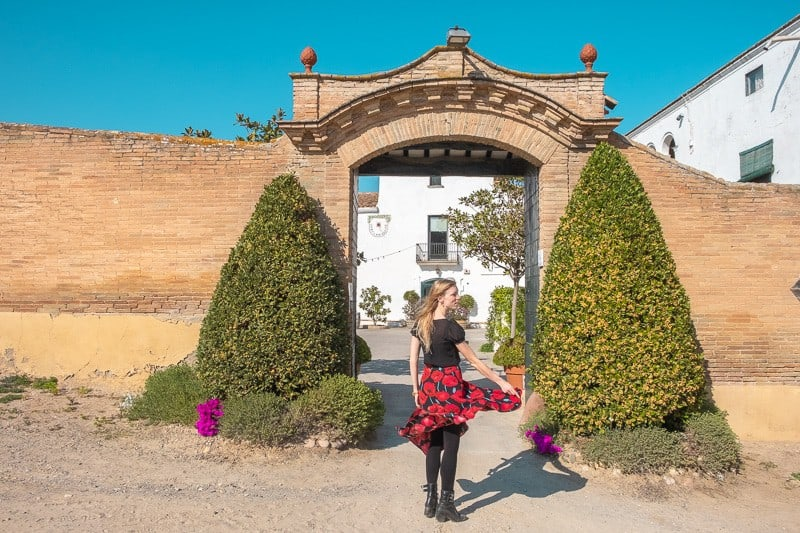 wine tour barcelona, wineries near barcelona, Cava Tasting in Ca N'Estella. clot dels oms, champagne tasting, catalonia, twirling blond girl entrance door