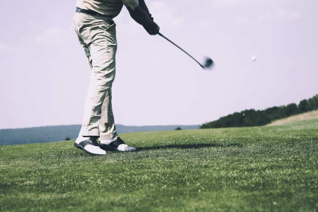 best wisconsin vacation ideas, man playing golf