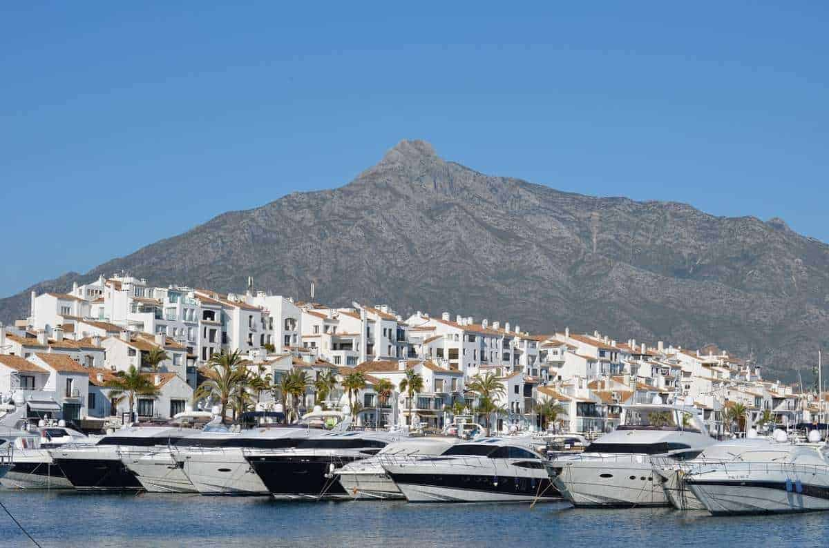 day trip to marbella from malaga, view of yachts at puerto banus in marbella