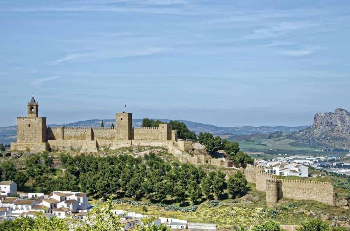 where to go for day trips near malaga, aerial view of alcazaba fortress in antequera spain