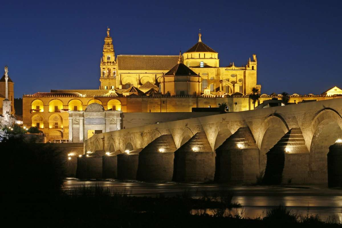 best day trips from malaga, la mezquita in corboda lit up at night