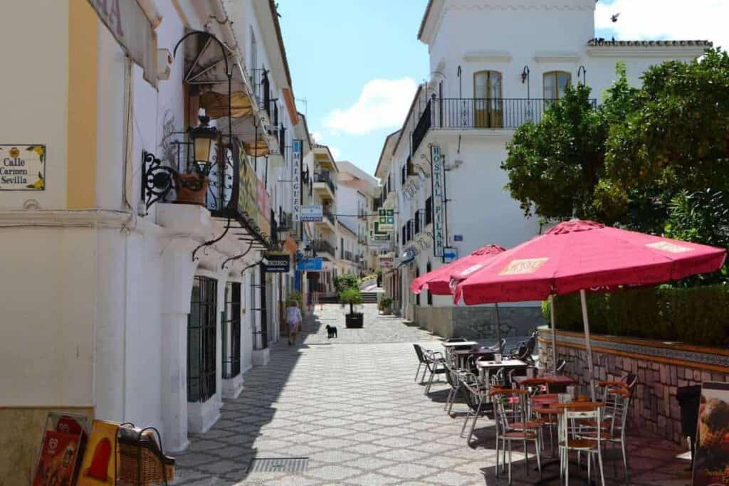 best day trips from malaga spain, white washed streets of estepona old town