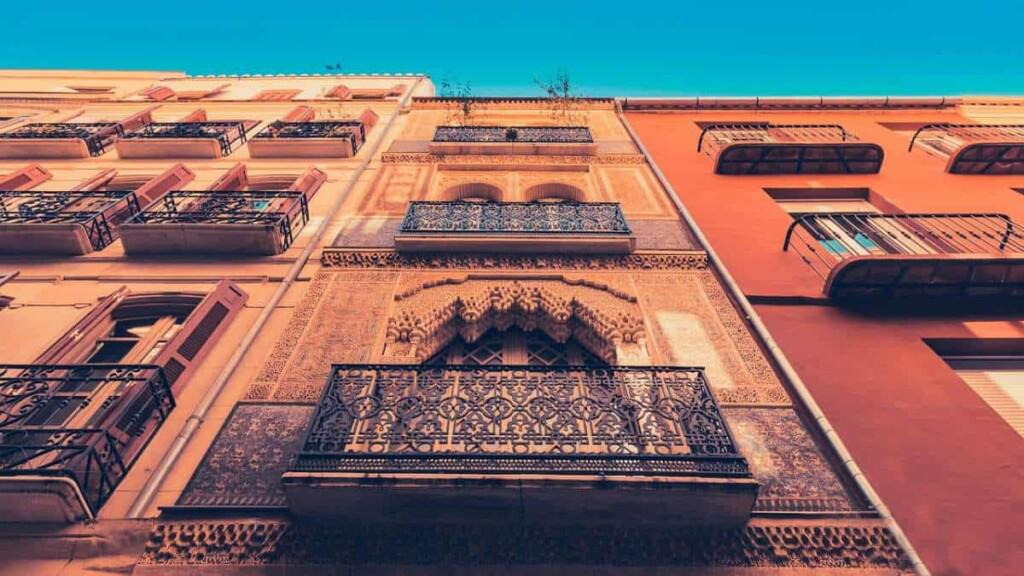 best tours in malaga spain, intricate carvings on side of building in malaga