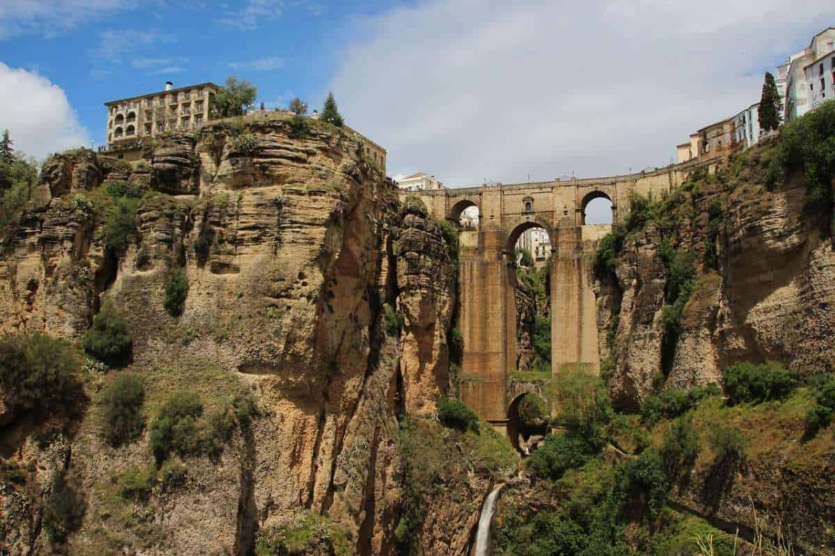 best day tours in malaga spain, view of bridge and homes on the cliffs of ronda