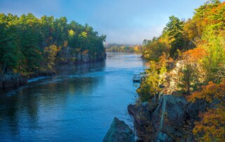 clearing morning fog on the st. croix river in interstate state park, minnesota, autumn.