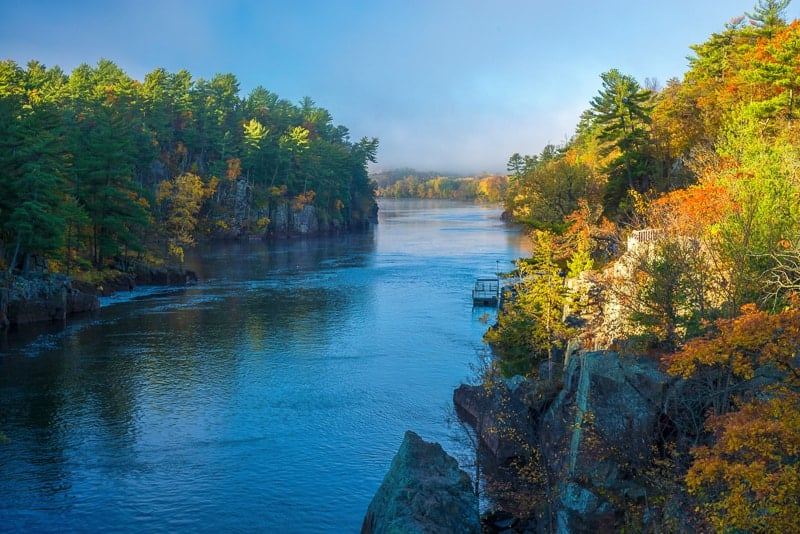 clearing morning fog on the st. croix river in interstate state park, minnesota, autumn. best state parks in wisconsin