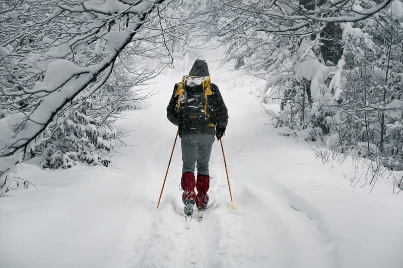 Person Trekking In The Snow