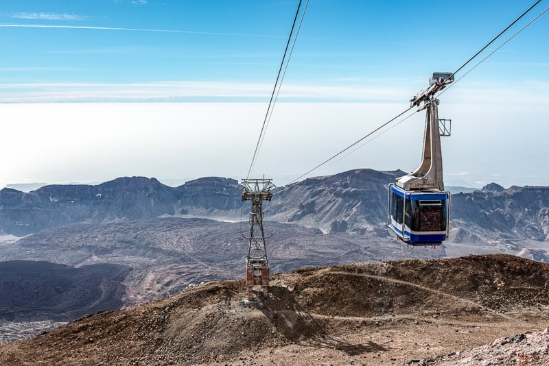 A cable car ascending Mount Teide On the island of Tenerife, with the old lava flows visible below.