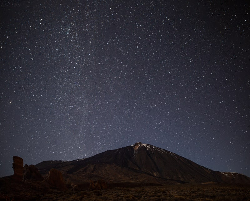 Night sky with shiny stars above volcano El Teide. Milky Way. Night in the Teide National Park, Tenerife, Canary Islands, Spain. Space background