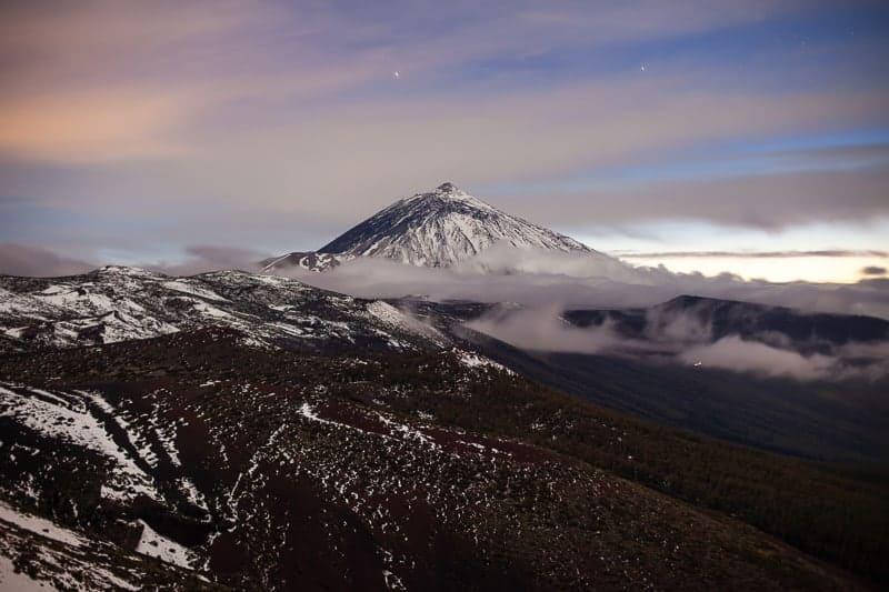 Sunset over snow volcano El Teide in winter. Nature landscape background