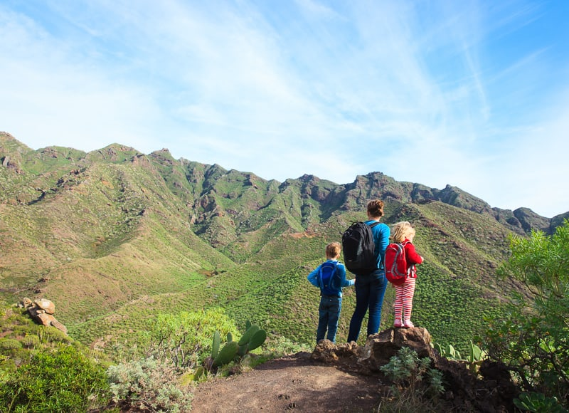 mother with little son and daughter hiking in mountains in tenerife, spain, canary islands, things to do in tenerife with kids