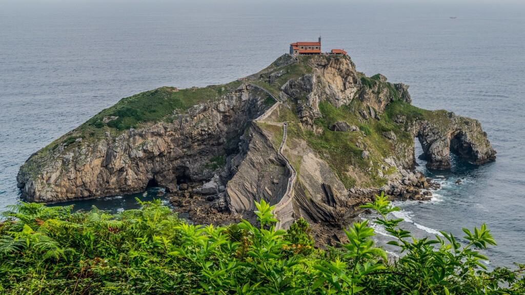 basque country spain, peninsula with house reaching into the sea