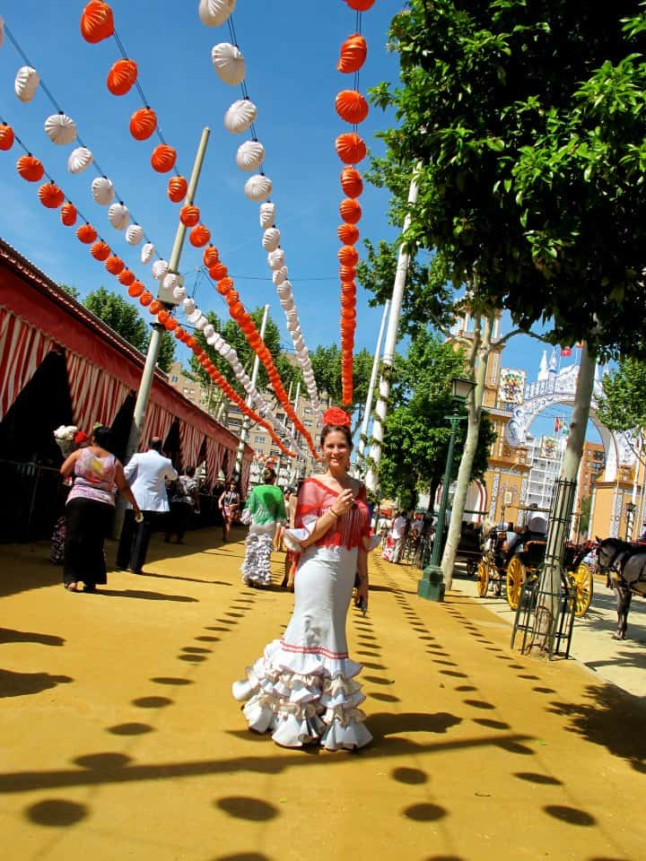 travel blogger girl in spanish dress in seville