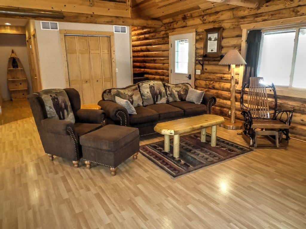 Romantic Cabins in Wisconsin, Inside view of cabin with log cabin decor & 'branch' rocking chair