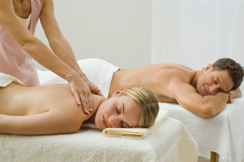 Best staycation ideas for couples, Couple receiving a massage