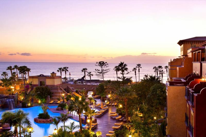 Best Family Hotels in Tenerife, A view of the pool and hotel at Europe Villa Cortes GL