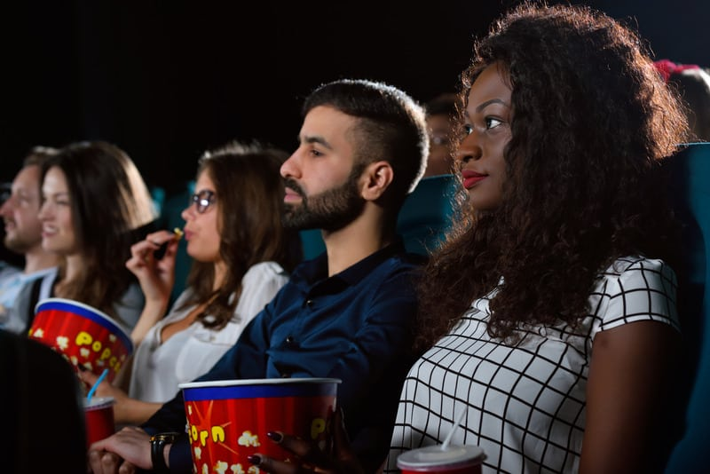 festivals in northern wisconsin, group of people with popcorn watching a film in a cinema