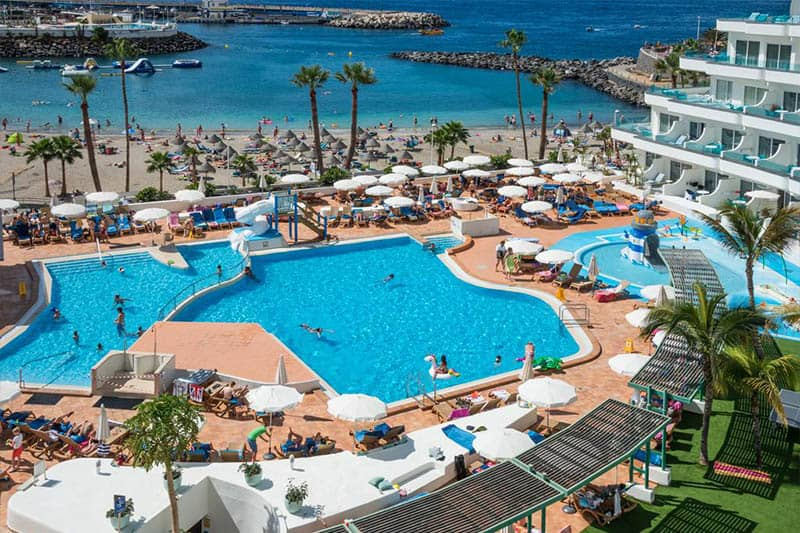 Best Family Hotels in Tenerife, A view of the pool at HOVIMA La Pinta Beachfront Family Hotel or Beach view
