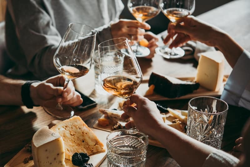 Staycation Ideas, Wine and cheese served for a friendly party in a bar or a restaurant.