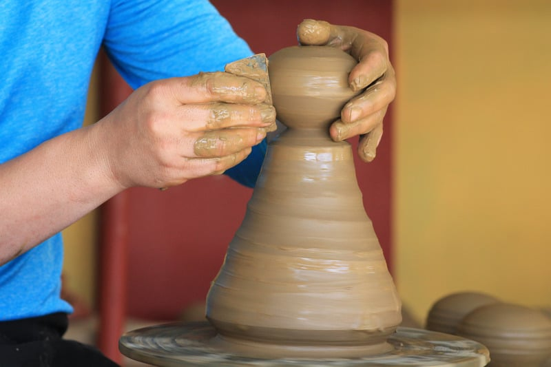 Things to do in Santiago Island, Cape Verde, Man creates vase on clay pottery wheel