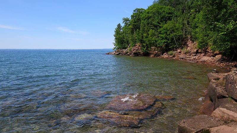 Things to do in Northern Wisconsin, blue water with sky view of Big Bay State Park, Madeline Island, Wisconsin