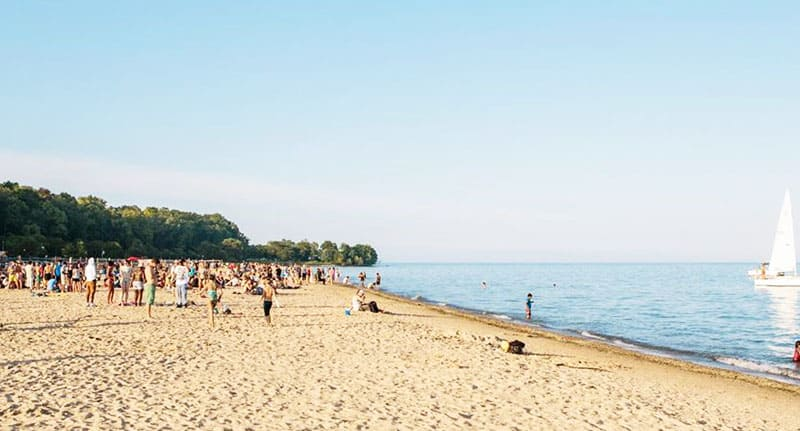 Best Urban Beaches in Wisconsin, View of Bradford Beach with People are enjoying a holiday on the beach