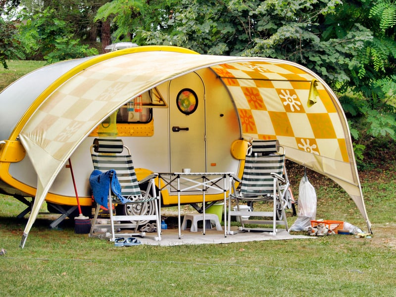Best things to Do in Door County, Wisconsin , Caravan at camping site,  table and empty chairs in front of