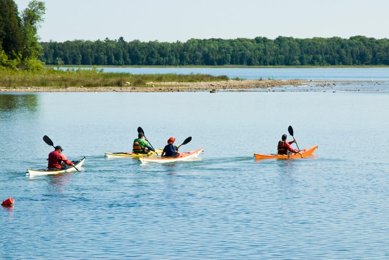 things to do in northern wisconsin, Some people kayaking in the lake of Northern Wisconsin