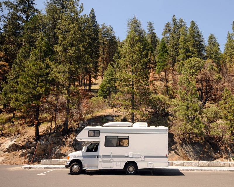 Cool things to do in Northern Wisconsin, RV Camper on highway with best back view, Recreational vehicle on a scenic mountain road
