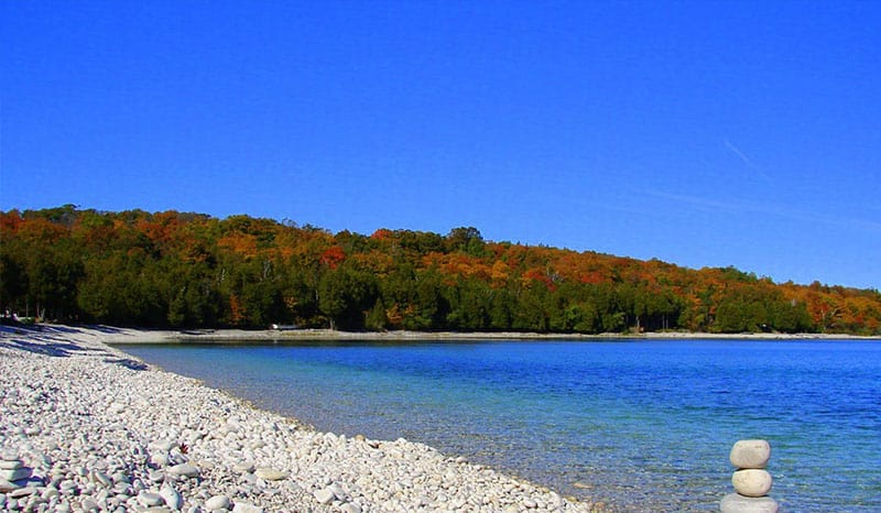 Cool Beaches in Wisconsin, best blue sky with green forest view in Schoolhouse Beach, Washington Island
