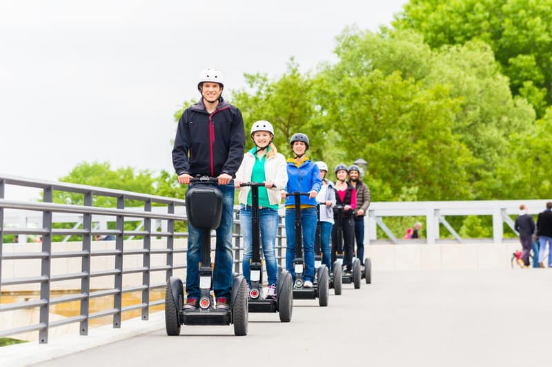 top attractions in door county, Tourist group driving Segway at sightseeing tour