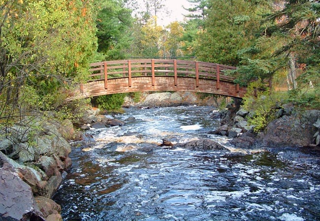 Cool things to do in Northern Wisconsin, beautiful foot bridge and view of pattison state park wisconsin