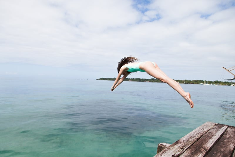 swimewear- Photo of Woman Diving Into the Water, eco friendly swimwear brands