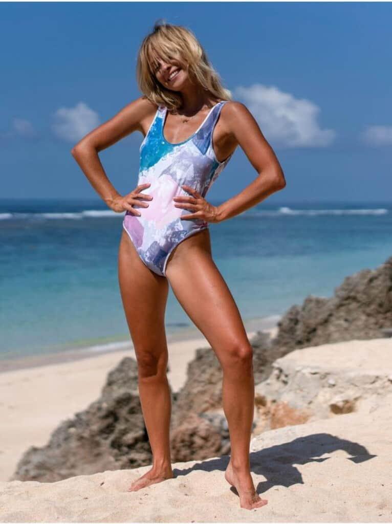 woman posing in Waiswim full-body swimsuit; sustainable affordable swimwear