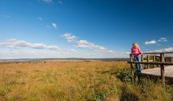 Best Hiking Trails in Belgium, A girl with a view of the blue sky and the farm