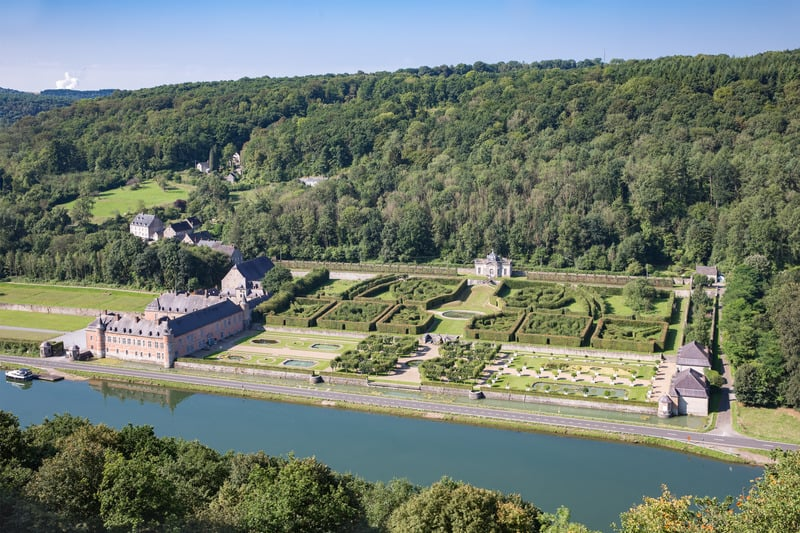 must see castles in belgium, Aerial view chateau Freyr along river Meuse near Dinant in Belgium