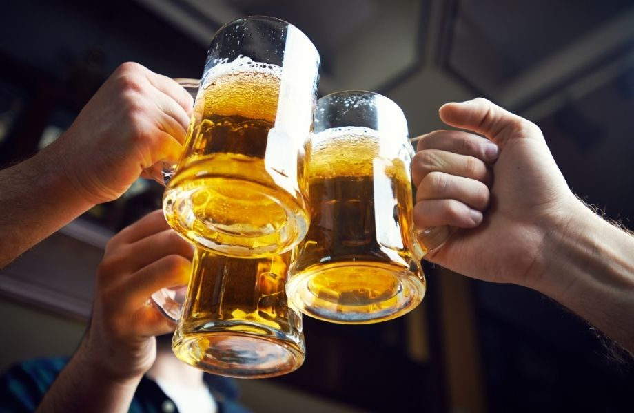 best things to do in Door County, three people clinking beer mugs