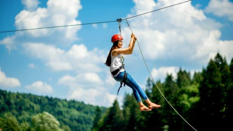 Fun things to do in Wisconsin in October, Women riding on a zip line