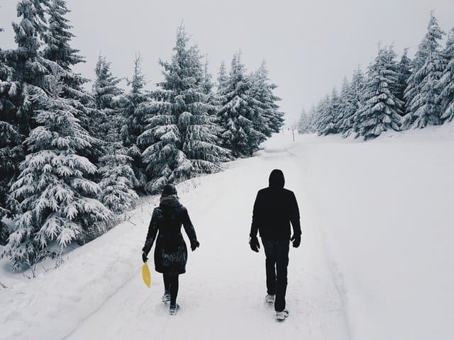 Beautiful ski resort for family in wisconsin, photograph of two persons in the middle of the road